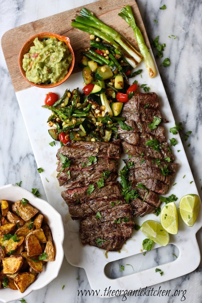 Using a simple marinade, this grilled skirt steak with seared veggies and guacamole will become a favorite family dinner. It's easy enough for a weeknight meal, but pretty enough for company!