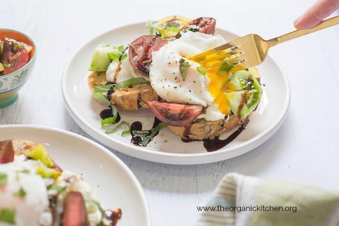 Heirloom Tomato Burrata Toast with Poached Eggs!